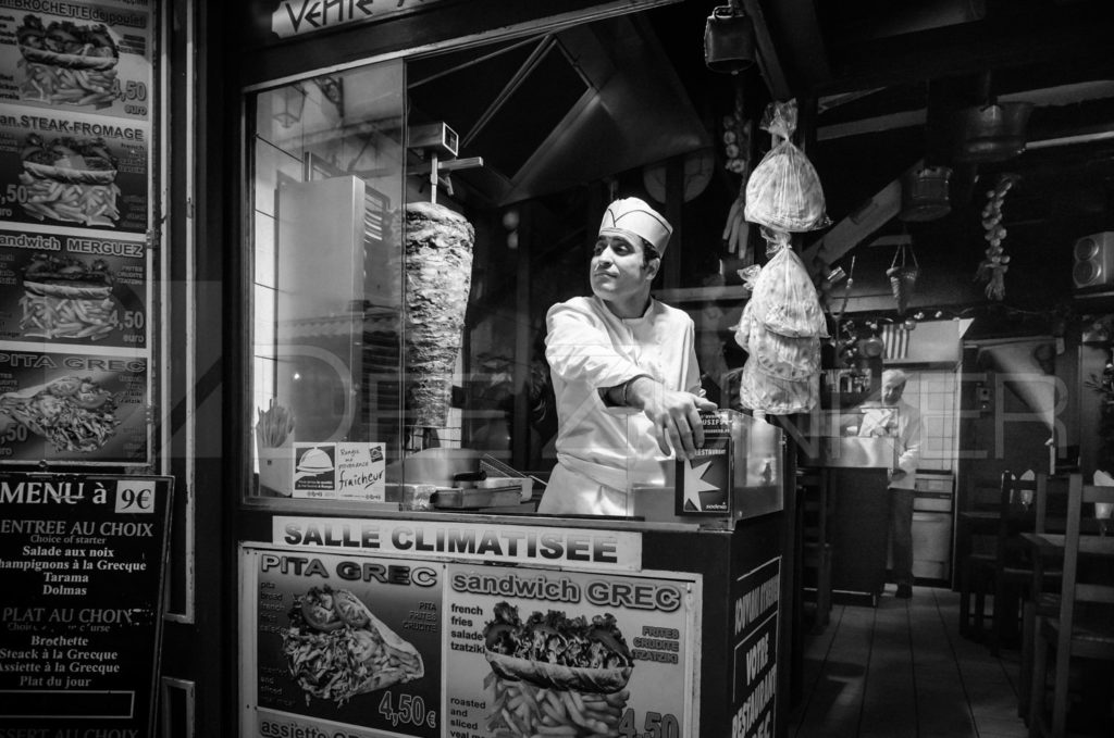 "Greek Sandwich Vendor - Paris, 2011Awarded ""Best in Show"" 2013 HPS Annual CompetitionSelected by Sally Sprout for the VAA 32nd Juried Open Exhibition  Paris_Street_01.dng  Houston Commercial Architectural Photographer Dee Zunker"