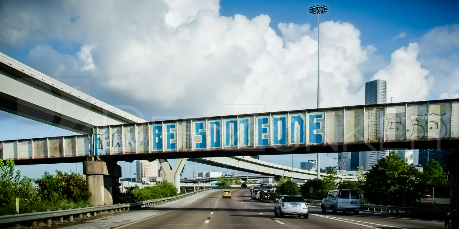 Be Someone Graffiti over I-45 just north of Downtown Houston by Architectural Commercial Photographer Dee Zunker